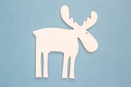 White wooden stencil of deer on a background. Banco de Imagens