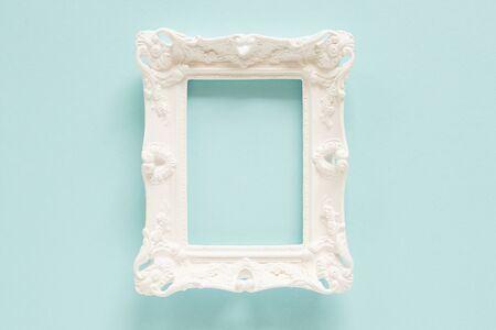White empty decorative frame on the blue background. Banco de Imagens