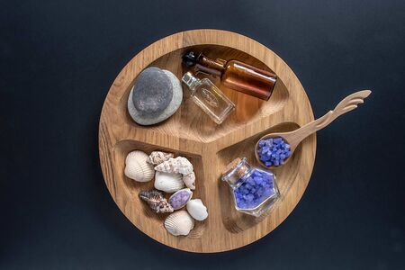 Seshels and seastones, bottles, lavender salts on the wooden round form.