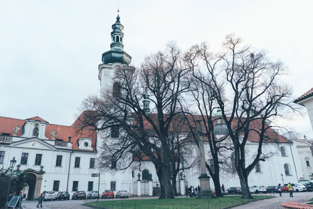 Panorama of the facade of the Monastery of Fears in Prague on a cloudy winter day.