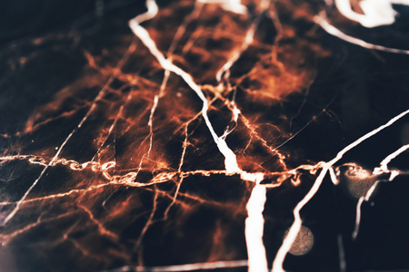 White and red patterns on black marble background. Copy space for text.