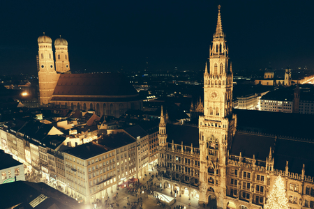Aerial view of the tower from the Marienplatz square in Munich, Christmas festivities in Europe, street scenery and night lighting. Stok Fotoğraf