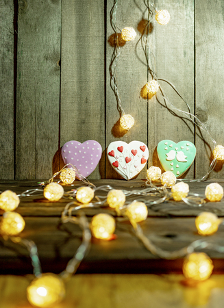 Christmas garland and gingerbread on a wooden background
