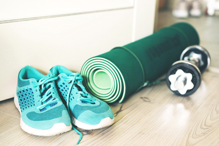 Sports set at home, sneakers, mat and dumbbells for fitness, healthy lifestyle Banco de Imagens