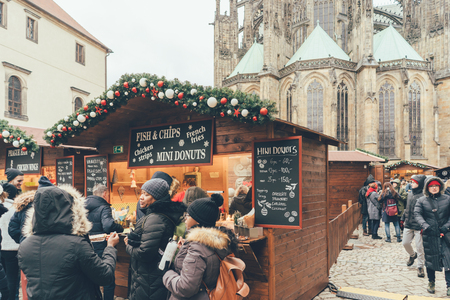 Czech Republic, Prague - December 24, 2018: Queue at the traditional Christmas market in Prague on the square in front of St. Vitus Cathedral Editorial