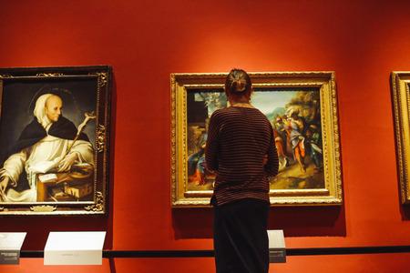 Italy, Milan - April 5, 2018: a girl examines paintings in Pinacoteca