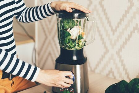 A large blender bowl whips the ingredients for a smoothie. Healthy eating. Stock fotó