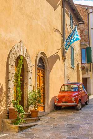 montepulciano: The street with old red car in Montepulciano