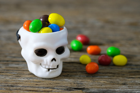 cranium: Candy colors contained in the tank white cranium skull. Stock Photo