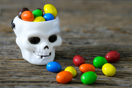 Candy colors contained in the tank white cranium skull. Stock Photo