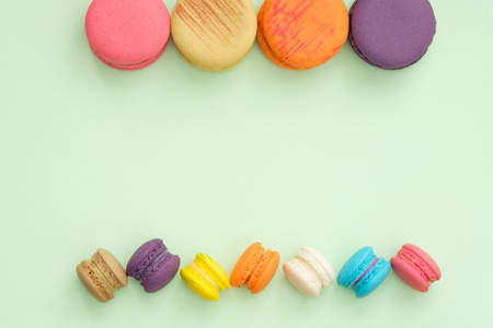 colorful macaroons on green background, Sweet and tasty for cooking and restaurant menu, Dessert beautiful, Top view, Space to write. pastel colors, vintage card. Stock Photo