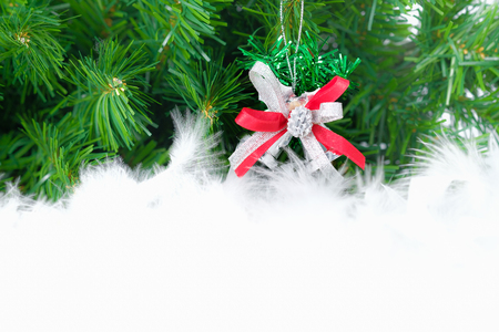 space to write: christmas decorated ornament hanging in fir tree. Open space for write, AF point selection. Stock Photo