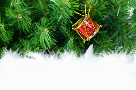 christmas decorated ornament hanging in green fir tree. Open space for write, AF point selection.