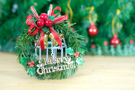 space to write: christmas decorated ornament on the wooden table and fir tree background. Open space for write, AF point and blur selection. Stock Photo