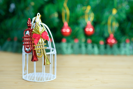 december 25: christmas decorated ornament on the wooden table and fir tree background. Open space for write, AF point and blur selection. Stock Photo