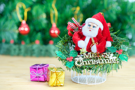 dazzling: christmas decorated ornament on the wooden table and fir tree background. Open space for write, AF point and blur selection. Stock Photo