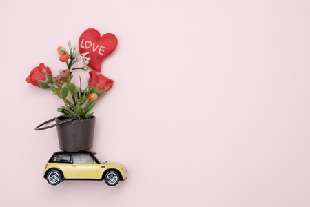 Toy car carrying flower in tha tank, Concept of valentine day, AF point selection.
