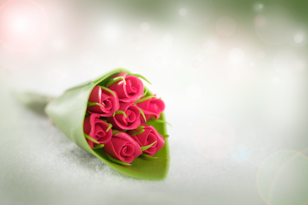 The red rose on abstract bokeh background in love concept for valentines day with romantic moment.