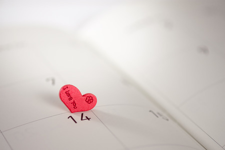 reminding: Calendar page with the red hearts on February 14 of Saint Valentines day, AF point selection.