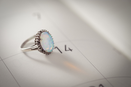 reminding: Calendar page with the Opal Ring on February 14 of Saint Valentines day, AF point selection. Stock Photo