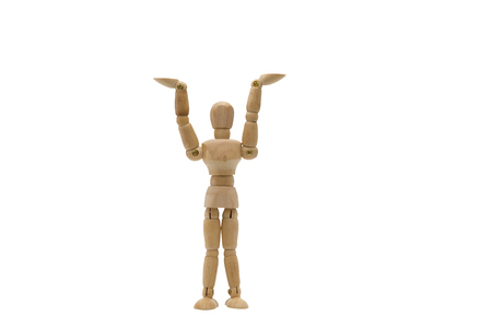 Wooden dummy motion was raised to something, Hands up isolated on a white background.