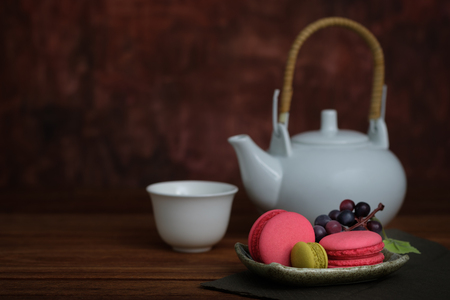 Still life macaroon dessert for ceramic dish on rustic wooden table, Choose a focal point, copy space for write.