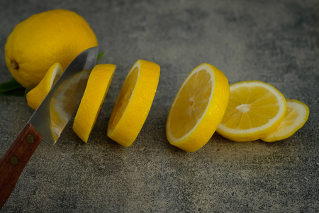 Still life with lemons on rustic low key background, Choose focal point, dark light style.