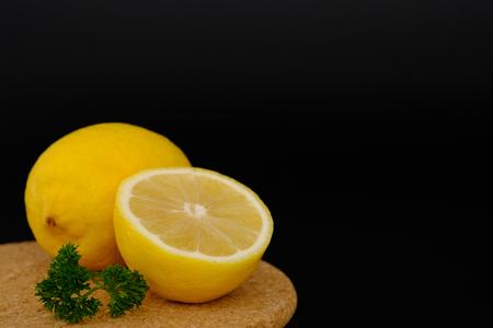 Still life with lemons on black background, Choose focal point, dark light style.