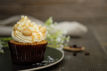 Cupcakes are beautifully decorated in Dark lighting, AF point selection.