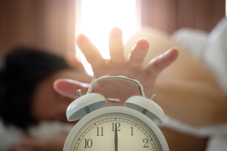 The hand under the blanket extends to the alarm clock in the morning, with light orange.