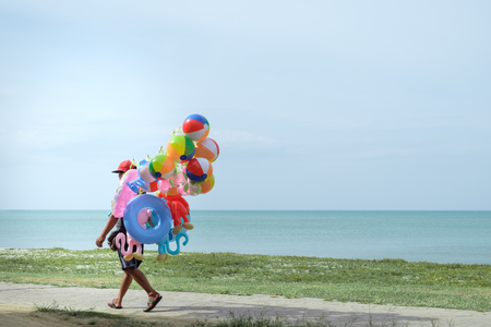 Balloon salesman by the sea with copy space to write.