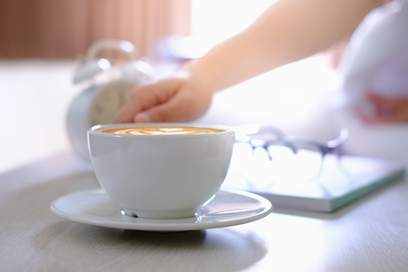 Women are drinking coffee on the bed in the morning. Stock Photo