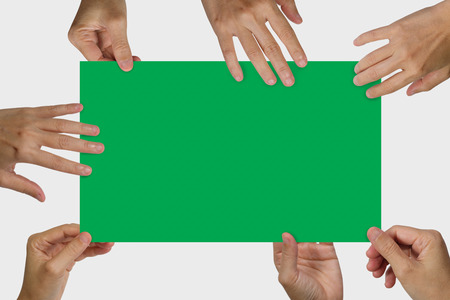 Many hands holding a white blank poster for advertising on an isolated white background, concept and idea for business.