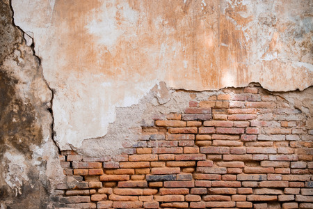 Old orange brick wall in antiquity and was damaged by the time until the mortar fell. Stock Photo