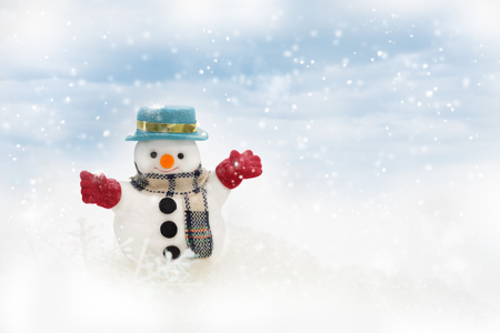 Happy snowman is standing in winter christmas landscape, Merry Christmas and happy New Year concept.