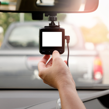 Hand-tuning car camera for safety on the road accident with white screen. Imagens