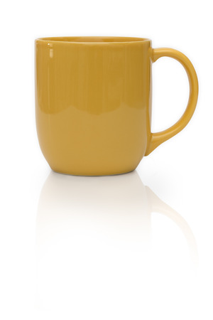 yellow ceramic mug or Coffee cup isolated on white background. Stock Photo