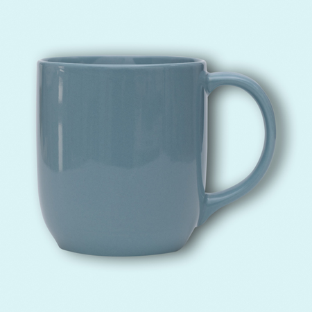 Blue ceramic mug or Coffee cup with shadow isolated on blue background. Stock Photo
