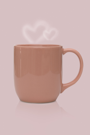 Pink ceramic mug or Coffee cup with heart smoke isolated on pink background. Stock Photo