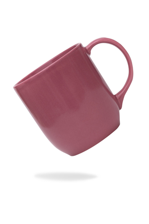 Pink ceramic mug or Coffee cup with shadow isolated on white background.