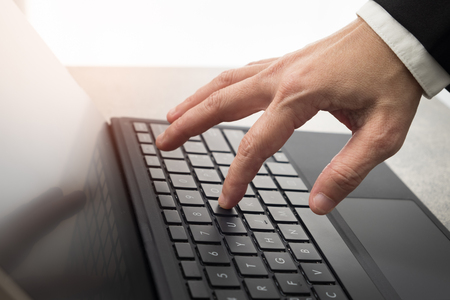 Hands are typing on the computer keyboard, people and technology concept. Stock Photo