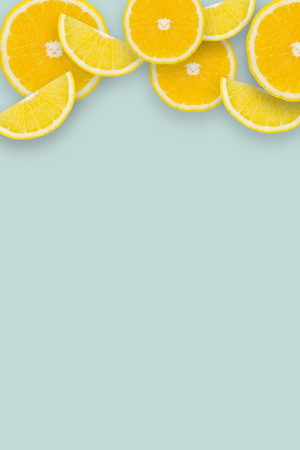 Lemon slices pattern on blue background Flat lay. Food concept.