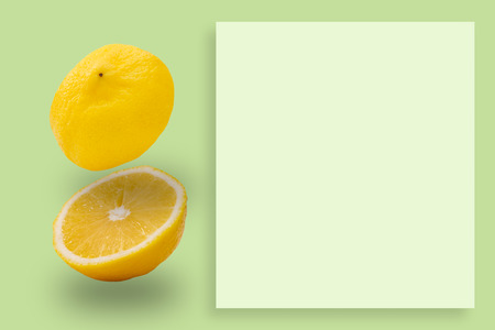 Lemon slices pattern on green background. Food concept.