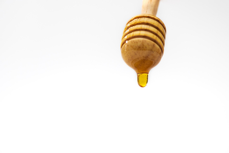 A honey dripper on white background. Food concept.