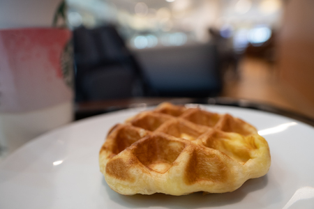 The waffle on white plate. Selective focus.