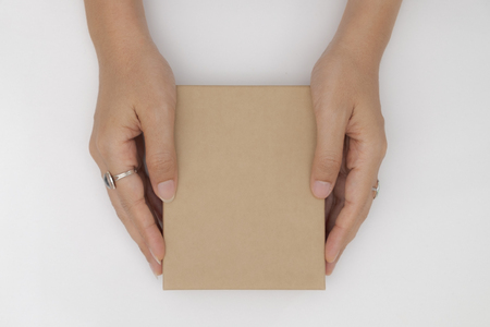 Top view two hands holding and open the empty gift box isolated white background.
