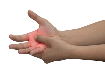 A woman massaging her painful hand isolated on a white background with red color on hand.