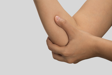 A woman touching her painful elbow, Healthcare And Medicine concept.