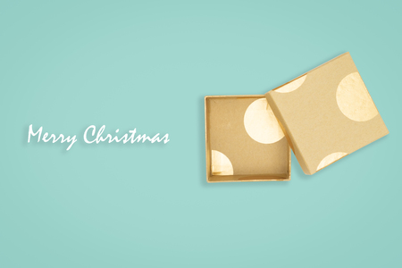 Top view of opened golden gift box on green background. with copy space for text.
