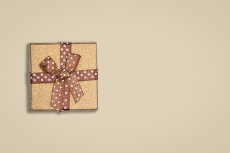 Top view of blown gift box on brown background. with copy space for text.